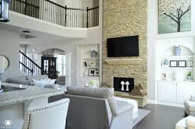 two story living room two story living room with stacked stone fireplace and catwalk