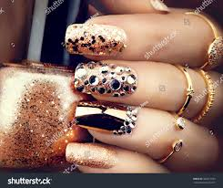golden nail art manicure holiday style stock photo 366871553