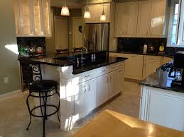 Kraftmaid Kitchen Cabinets Furniture Cozy Black Granite Countertop With Pendant Lighting And
