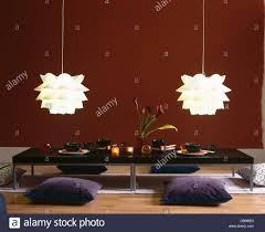 white folded plastic ceiling lights above gray floor cushions and