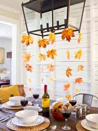 hang leaf streamers from light fixture thanksgiving table