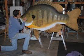 large wood sculpture big fish wood carver enjoys fishing for those fish he carves