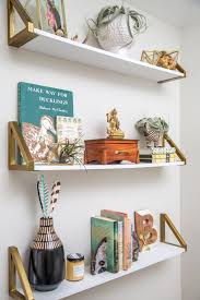on the shelf accessories 12 ways to decorate with floating shelves hgtv s decorating