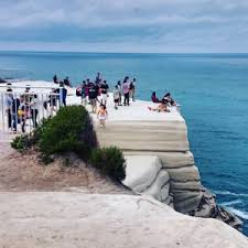 wedding cake rock thrillseeking tourists to be fined for jumping the safety fence at