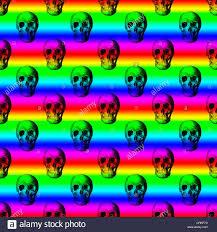 repeating background halloween repeat pattern of black skulls on a rainbow background stock photo