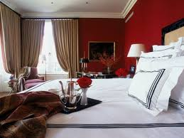 romantic bedroom using red wall colors and white bedding with