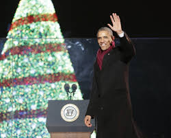 president obama busts a move with santa claus at the national tree