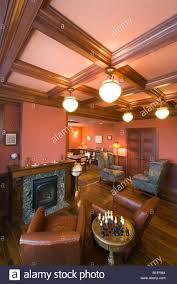 interior view of a study u0026 fireplace in a custom craftsman style
