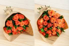 paper wrapped flowers orange roses in kraft paper wrapped roses in brattleboro