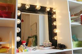 bathroom dressing room with black wooden mirror frame with lights