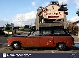 old peugeot stock photo of an old peugeot 403 piled high with bric a brac the
