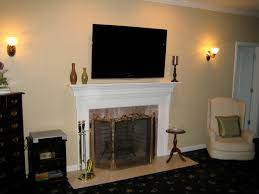 interior double sconce lighting design with mounting tv above