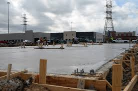 the foundation is poured and the steel structure is up