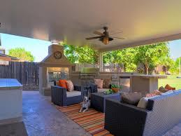 modern outdoor living room green grass backyard orange clay vase