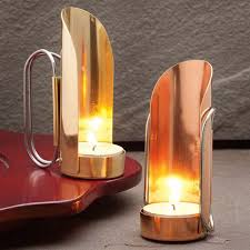 brass and copper tea candle holders with wind shield reflector