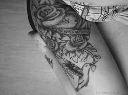 45 wonderful clock tattoos on thigh