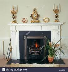 gilt candelabra and antique gilt clock on mantelpiece above