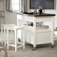 white kitchen island with butcher block design and square white