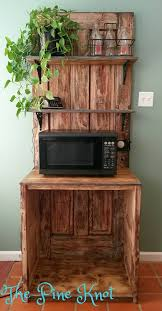 2 old doors transformed into a microwave stand with shelves we