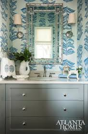silver and black powder room with silver leaf wallpaper