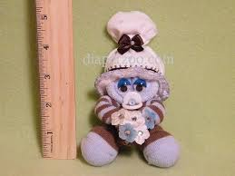 Baby Sock Corsage Diaper Cake Instructions Diaperzoo Com Baby Showers Diaper