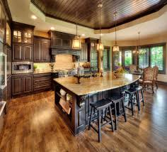 dark oak cabinets kitchen mediterranean with open floor plan