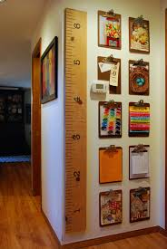 How High To Hang Art Thrifted Clipboards Used To Create A Gallery Wall For Kids Artwork