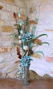 Feather And Flower Centerpieces by Floral Arrangements Peacock Floral Arrangement With Mirrored Vase