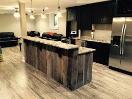 kitchen island gray natural finishes wood kitchen island with gray natural finishes wood kitchen island with granite top laminate wood floors stainless steel appliances