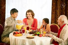 happy thanksgiving dinner portrait of happy family sitting at festive table and having