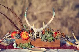 picture of antlers and feather centerpiece for a fall boho wedding