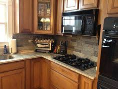 Rock Backsplash Kitchen by Our New Stacked Stone Backsplash We Used Airstone Sold At Lowes