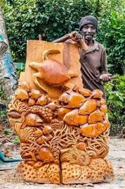 wood carving of a torso black jamaican home
