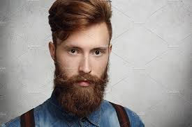 haircut photos freckles casual young bearded man with stylish haircut and freckles posing