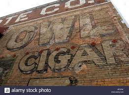 vintage painted mural on a brick wall advertising the scholl old advertising mural painted on brick for the country s largest domestic cigar manufacturer striation and