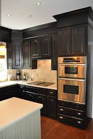Kitchen Furniture For Small Spaces Furniture Attractive Black Wooden Wall Mounted Cabinet In Kitchen