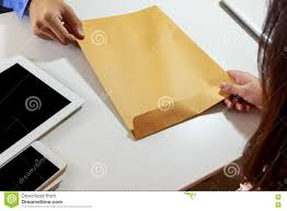 businesswoman receive letter envelope at office desk stock photo