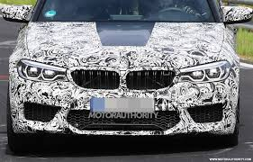 bmw m5 spy shots jeep compass off road review karma revero