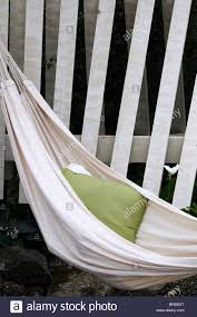 white linen hammock on wooden structure outdoor porch hang hanging
