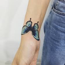small tattoos for men on wrist blue butterfly tattoo on the right wrist tattoo artist doy