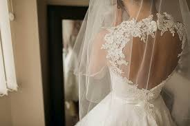 a 50 u0027s style gown and a 60 u0027s inspired short and pretty pouffy veil