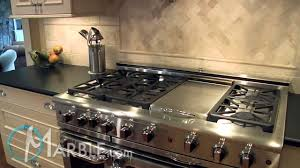 Black Granite Kitchen Countertops by White Black Mosaic Granite And Absolute Black Leathered Granite