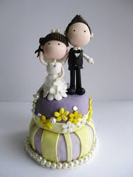 wedding cake figurines wedding clay cake topper standing on top of a cake not edible