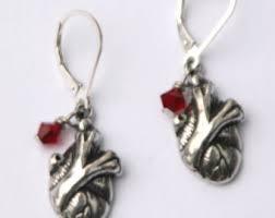 human earrings human heart earrings etsy