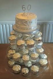 golden 50th anniversary cupcake tower with rosette top cake all
