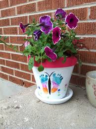 diy flower pots with baby foot butterfly i mod podged a photo of