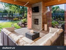 beautiful covered patio television fireplace couch stock photo