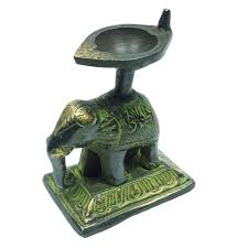 ethnic indian home decor diya on elephant statue table decor