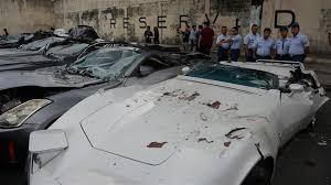 bureau cars presstv philippines duterte bulldozes high end cars