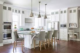 white kitchen island with gray velvet french counter stools